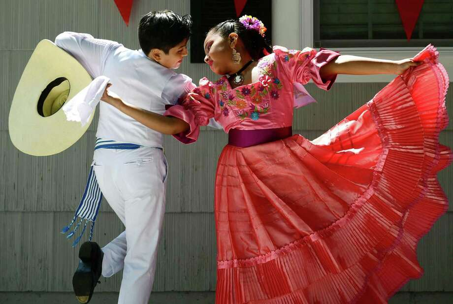 "Sebastian Serrano and Alina Mateo perfrom traditional Peruvian dance during the 3rd annual Peruvian Fundraiser hosted for Ready For School Peru Saturday, July 27, 2019, in Norwalk, Conn. The event celebrated Peru's Independence Day with a delicious Peruvian BBQ, picarones, a dance presentation by the dance studio ""Taller de Marinera Norteña"", a special presentation of criolla music singer, games, and raffles. 100% of all proceeds will be donated to Ready For School. Photo: Erik Trautmann / Hearst Connecticut Media / Norwalk Hour"