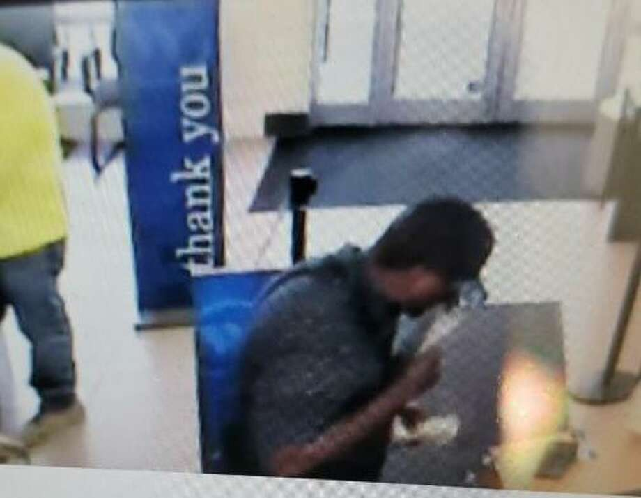 New Haven police released images of an armed bank robbery suspect, who allegedly took an undetermined amount of money from a city bank after he pulled out a gun during the robbery on Friday, July 26, 2019. Photo: Contributed Photo / New Haven Police Department