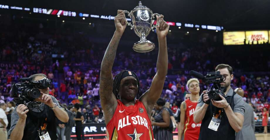 Indiana Fever's Erica Wheeler, of Team Wilson, holds up the MVP trophy after winning the honor at the WNBA All-Star basketball game Saturday, July 27, 2019, in Las Vegas. (AP Photo/John Locher) Photo: John Locher/Associated Press