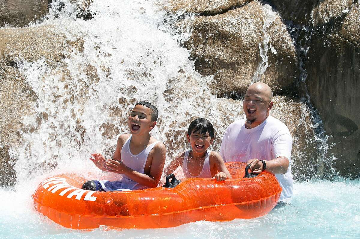 Kids of all ages seek relief from the sweltering heat at Six Flags Hurricane Harbor waterpark in Concord, Calif. on Saturday, July 27, 2019 where temperatures had already reached 94 degrees by early afternoon.