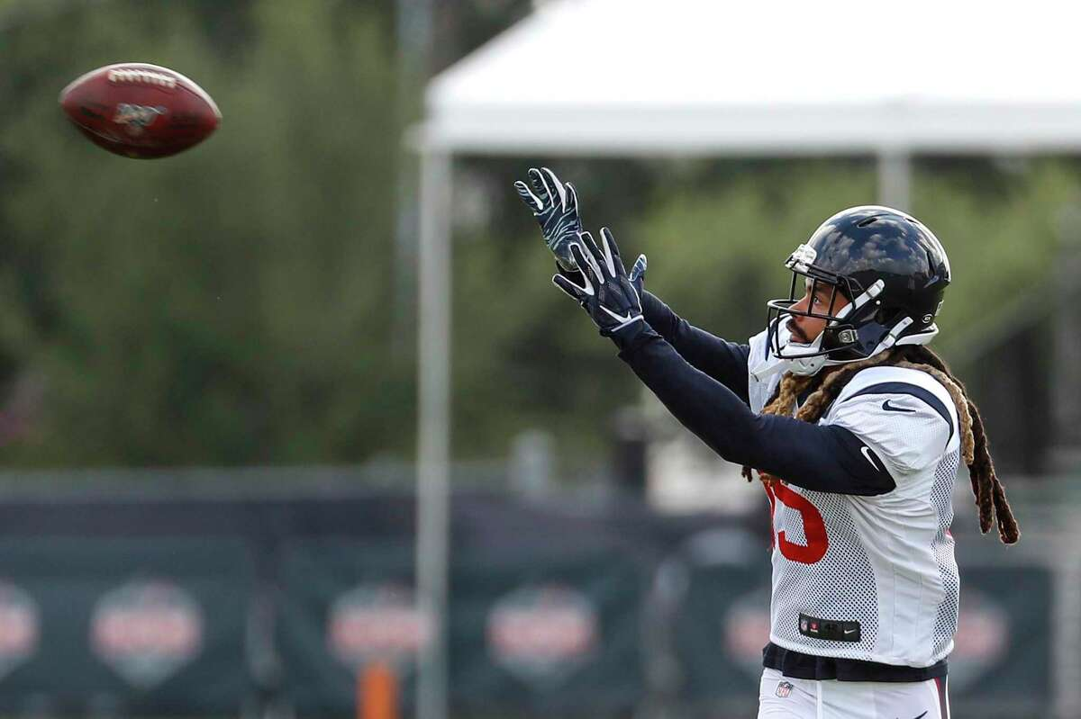 Will Fuller reaches to make a catch during training camp at the Methodist Training Center on Saturday. The wide receiver is expected to play in the season opener.