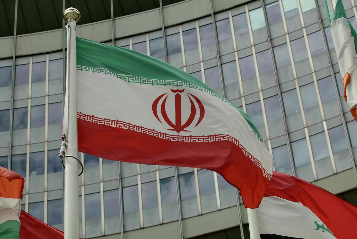 The Iranian flag waves outside of the UN building that hosts the International Atomic Energy Agency, IAEA, office inside in Vienna, Austria, Wednesday, July 10, 2019. President Donald Trumpa€™s a€œmaximum pressurea€ campaign against Iran is at a crossroads. His administration is trying to decide whether to risk stoking international tensions even more by ending one of the last remaining components of the 2015 nuclear deal. (AP Photo/Ronald Zak)