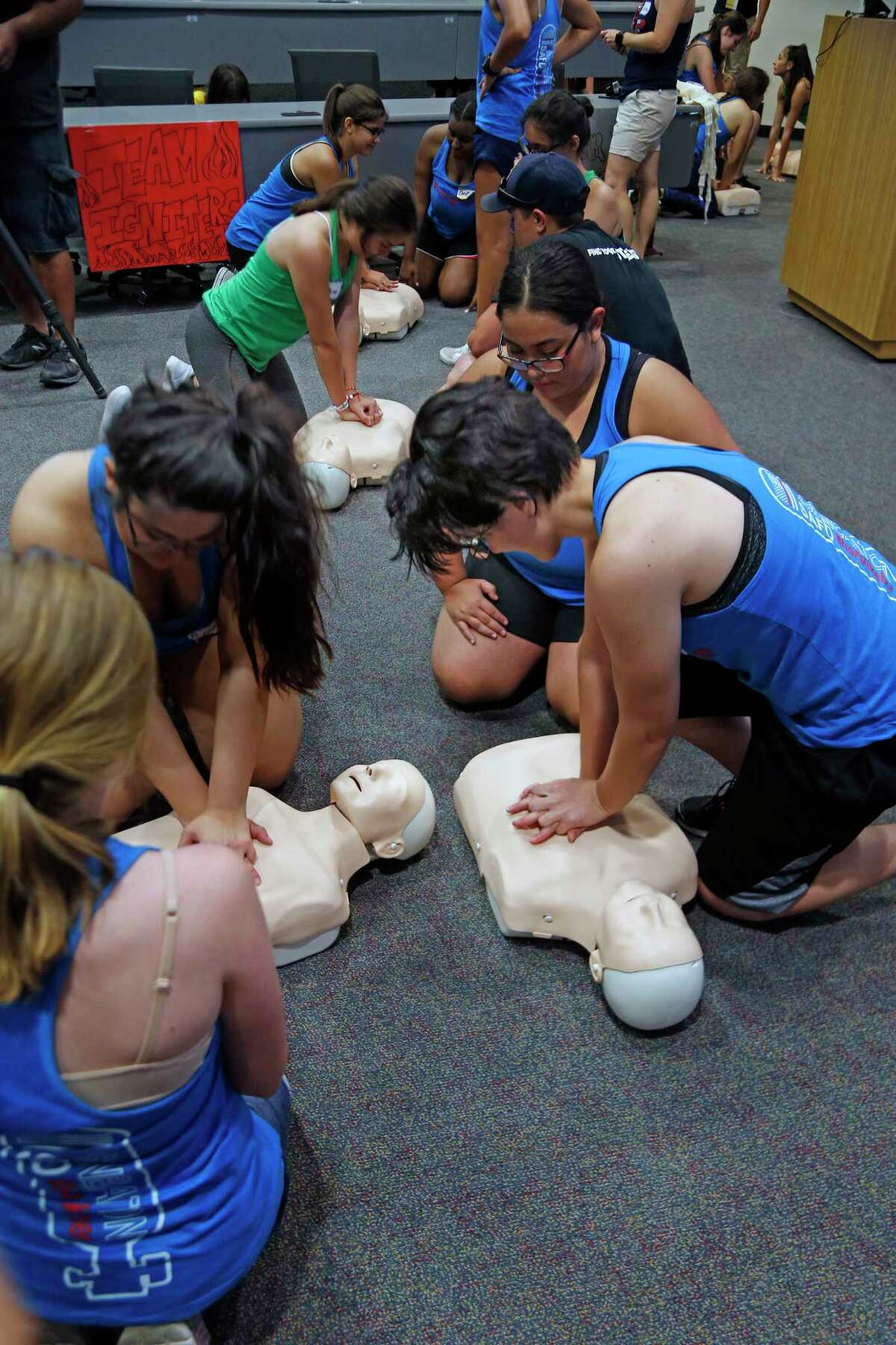 Girls try CPR. A special San Antonio Fire Department camp will give girls 14-18 hands-on experience at the SA Fire Academy to encourage a career in firefighting.on Saturday, July 27, 2019.