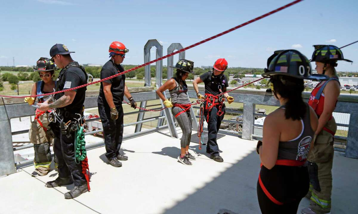 Annayelli Saldivar,14 and Isabella Cantu,14,R, are given final instruction right before they rappell. A special San Antonio Fire Department camp will give girls 14-18 hands-on experience at the SA Fire Academy to encourage a career in firefighting.on Saturday, July 27, 2019.