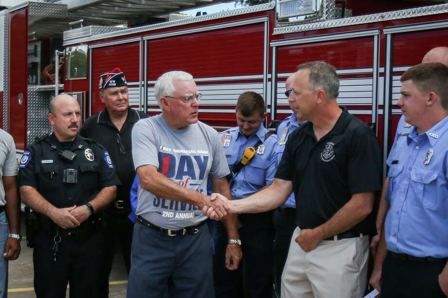 In this file photo, Sam Baker, Chairman and CEO of First Financial Bank Conroe Region, shakes hands with Conroe Fire Lt. Lloyd Sandefer, Conroe Professional Firefighters Association President, at the conclusion of an appreciation lunch for first responders on Monday, Oct. 9, 2017, at Conroe VFW Post 4709. Photo: Michael Minasi, Staff Photographer / Houston Chronicle / © 2017 Houston Chronicle