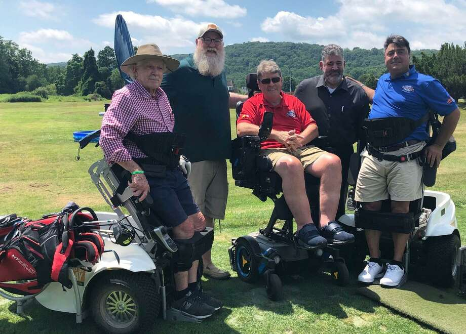 Anthony Netto, founder of the Stand Up and Play Foundation, recently held a clinic at Candlewood Valley Country Club in New Milford, where he showcased a paramobile that assists individuals with impaired mobility. Above, Netto, right, visits with, from left to right, Paul Arneth of Southbury, State Representative Bill Buckbee (R-67th), Stand Up and Play board member Gregory Jacobson of Wilton and New Milford Mayor Pete Bass. Photo: Deborah Rose / Hearst Connecticut Media / The News-Times  / Spectrum