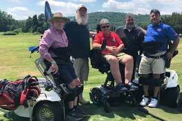 Anthony Netto, founder of the Stand Up and Play Foundation, recently held a clinic at Candlewood Valley Country Club in New Milford, where he showcased a paramobile that assists individuals with impaired mobility. Above, Netto, right, visits with, from left to right, Paul Arneth of Southbury, State Representative Bill Buckbee (R-67th), Stand Up and Play board member Gregory Jacobson of Wilton and New Milford Mayor Pete Bass.
