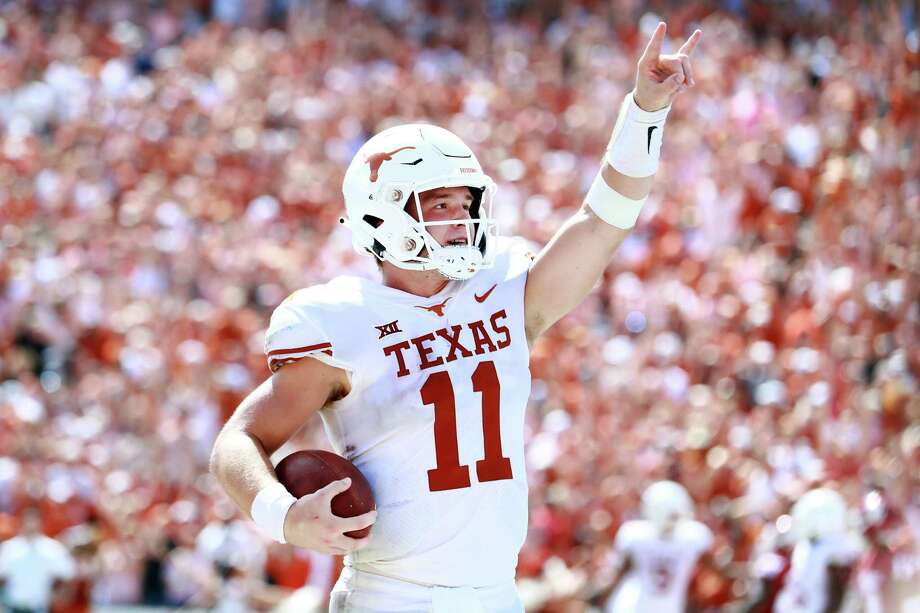 DALLAS, TX - OCTOBER 06: Sam Ehlinger #11 of the Texas Longhorns celebrates after scoring a touchdown against the Oklahoma Sooners in the third quarter of the 2018 AT&T Red River Showdown at Cotton Bowl on October 6, 2018 in Dallas, Texas. (Photo by Tom Pennington/Getty Images) Photo: Tom Pennington, Staff / Getty Images / 2018 Getty Images