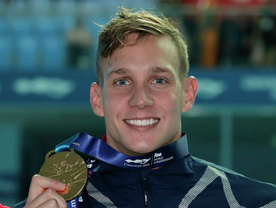 Gold medalist United States' Caeleb Dressel poses with his medal following the men's 100m butterfly final at the World Swimming Championships in Gwangju, South Korea, Saturday, July 27, 2019. (AP Photo/Lee Jin-man) Photo: Lee Jin-man / Copyright 2018 The Associated Press. All rights reserved