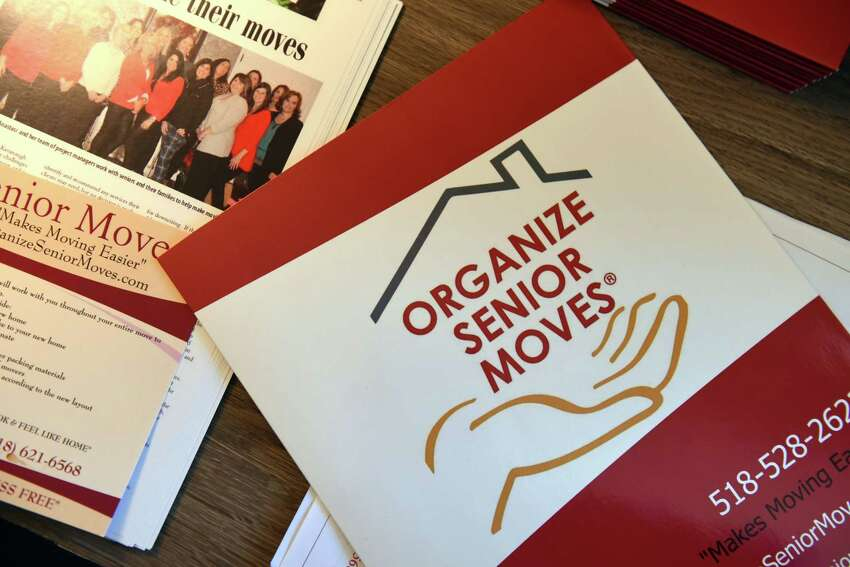 Literature for Organize Senior Moves on Wednesday, July 24, 2019, in Delmar, N.Y. The company helps seniors to downsize. (Will Waldron/Times Union)