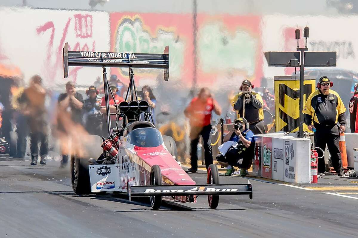 Clay Millican, the top qualifier in Top Fuel, takes off on Saturday at Sonoma Raceway.