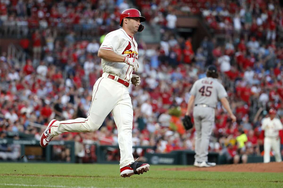St. Louis Cardinals' Paul Goldschmidt, left, rounds the bases after hitting a solo home run off Houston Astros starting pitcher Gerrit Cole, right, during the fourth inning of a baseball game Saturday, July 27, 2019, in St. Louis. (AP Photo/Jeff Roberson)