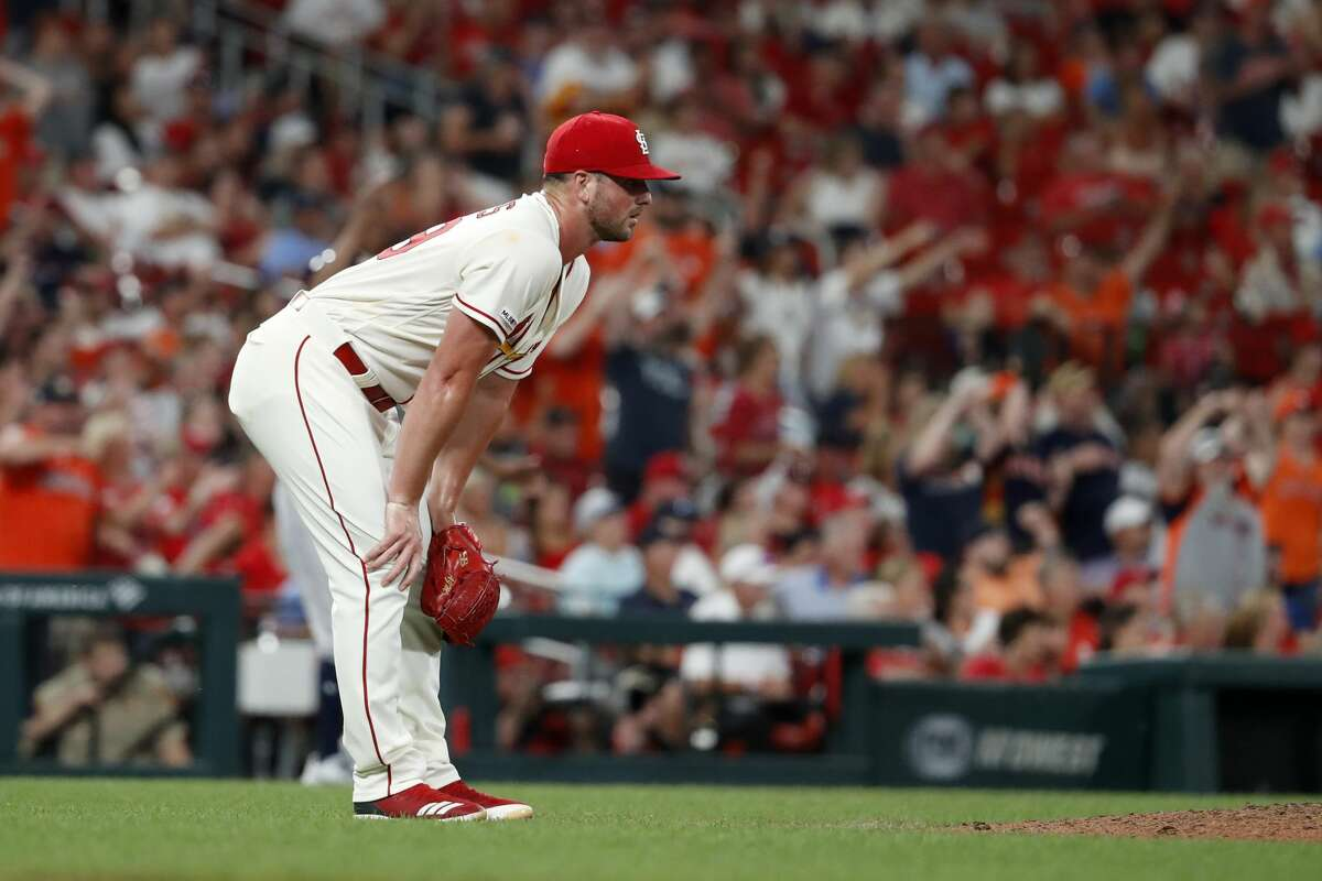 St. Louis Cardinals relief pitcher Mike Mayers reacts after giving up a triple to Houston Astros' George Springer during the eighth inning of a baseball game Saturday, July 27, 2019, in St. Louis. (AP Photo/Jeff Roberson)
