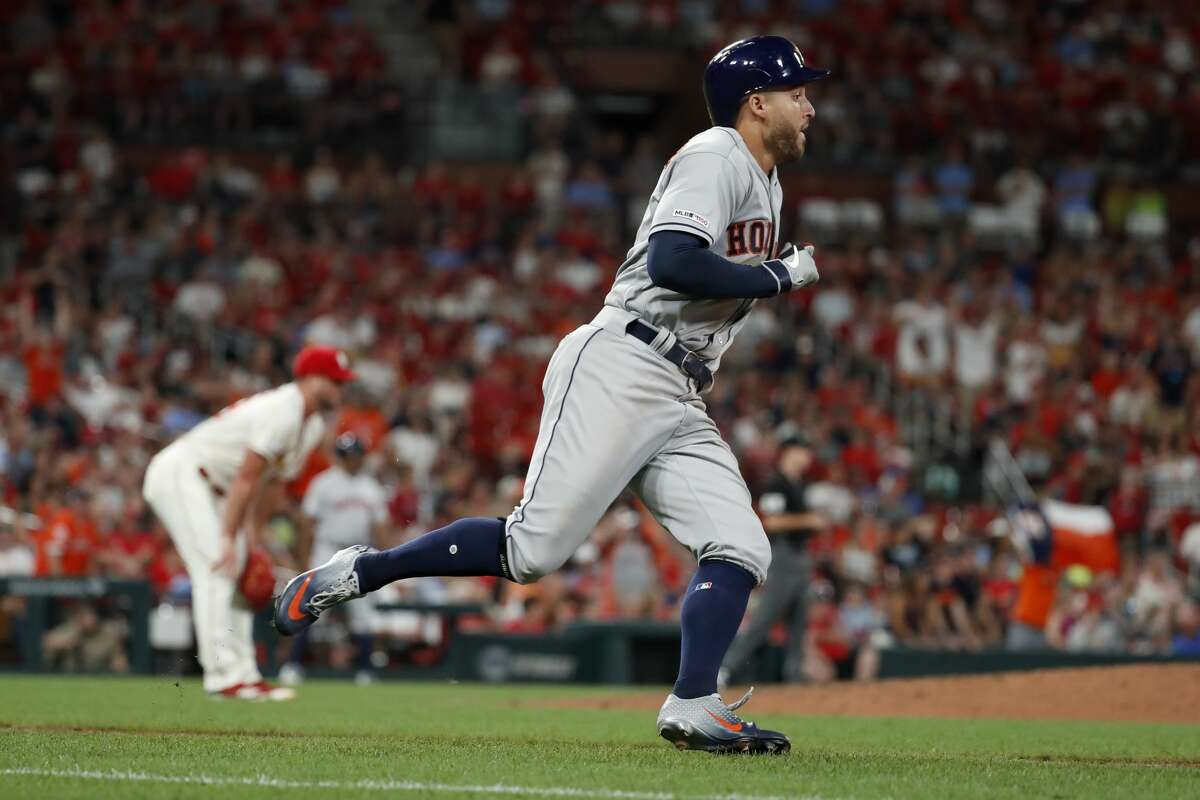 Houston Astros' George Springer, right, triples off St. Louis Cardinals relief pitcher Mike Mayers, left, during the eighth inning of a baseball game against the St. Louis Cardinals Saturday, July 27, 2019, in St. Louis. (AP Photo/Jeff Roberson)