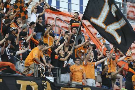 Houston Dynamo fans cheer for the team during the first half of the MLS game against the Seattle Sounders at BBVA Stadium on Saturday, July 27, 2019, in Houston.