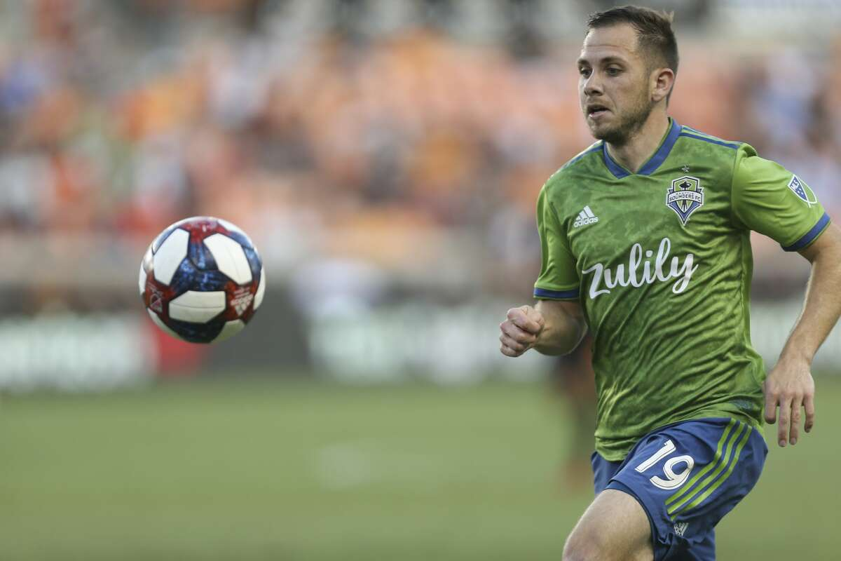 Seattle Sounders forward Harry Shipp (19) follows the ball during the first half of the MLS game against the Houston Dynamo at BBVA Stadium on Saturday, July 27, 2019, in Houston.