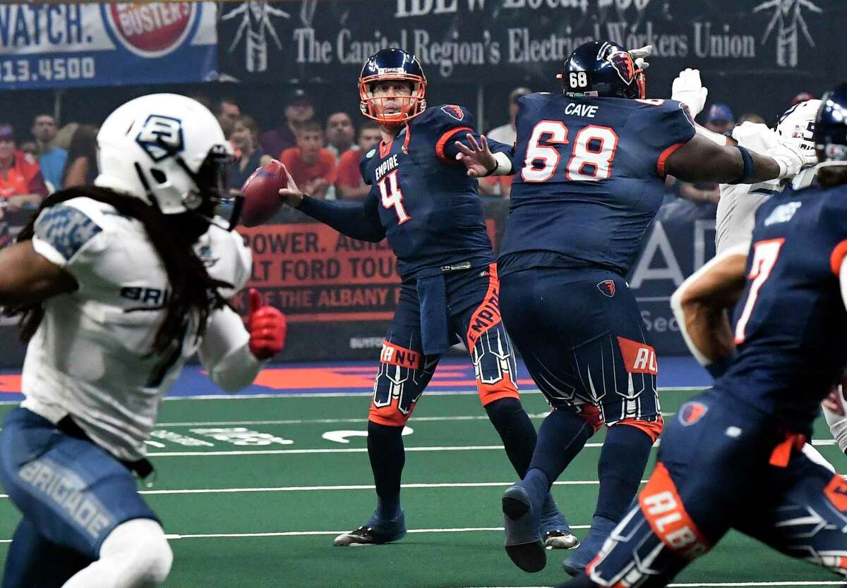 Albany Empire's Tommy Grady (4) throws a pass against the Baltimore Brigade's during a arena football league playoff game Saturday, June 27, 2019, in Albany, N.Y. (Hans Pennink / Special to the Times Union)