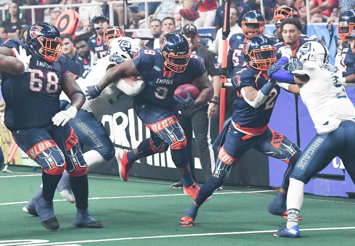 Albany Empire's Mykel Benson (9) runs the ball against the Baltimore Brigade's during a arena football league playoff game Saturday, June 27, 2019, in Albany, N.Y. (Hans Pennink / Special to the Times Union)
