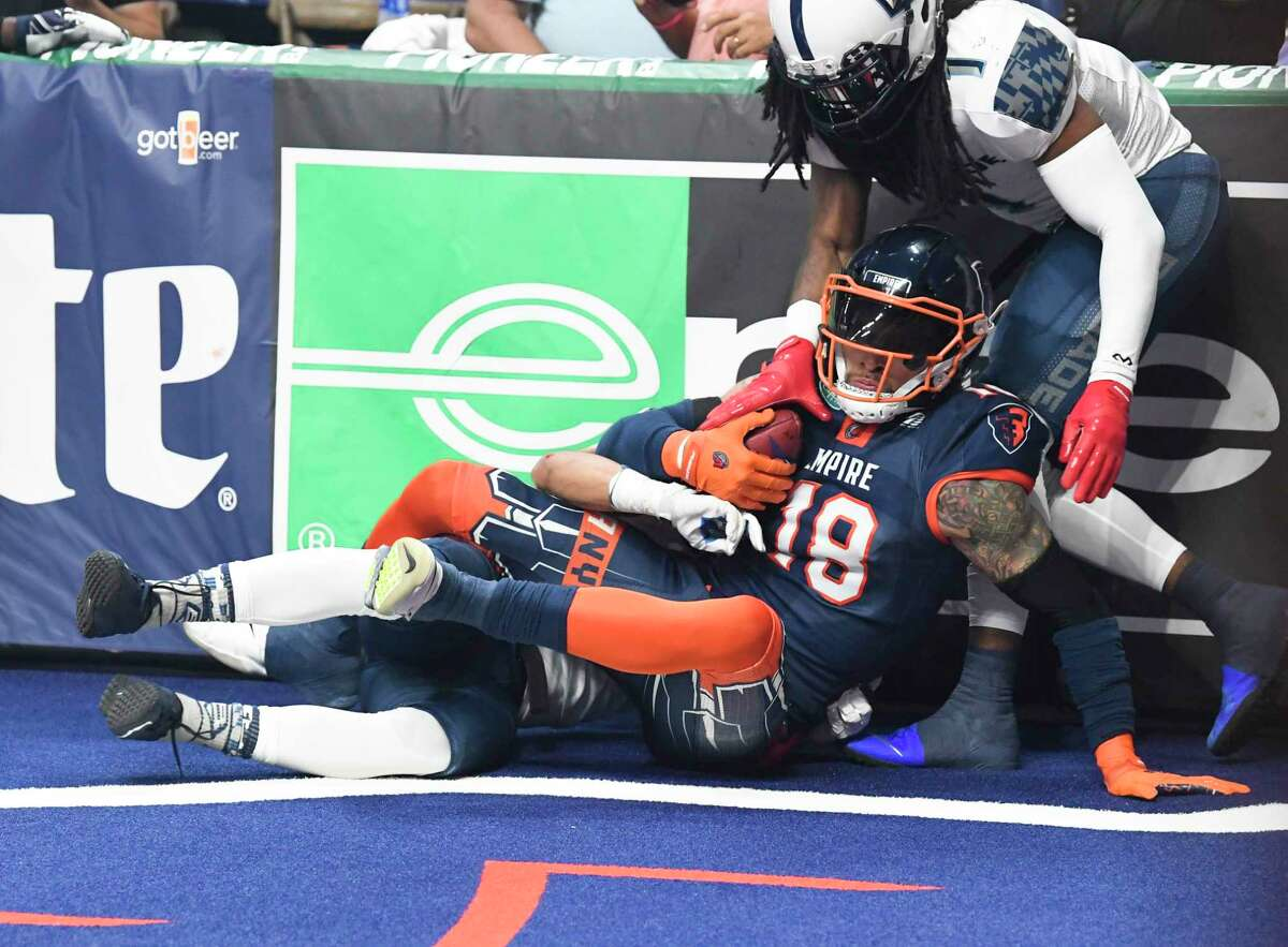 Albany Empire's Quentin Sims (18) scores against the Baltimore Brigade's during a arena football league playoff game Saturday, June 27, 2019, in Albany, N.Y. (Hans Pennink / Special to the Times Union)