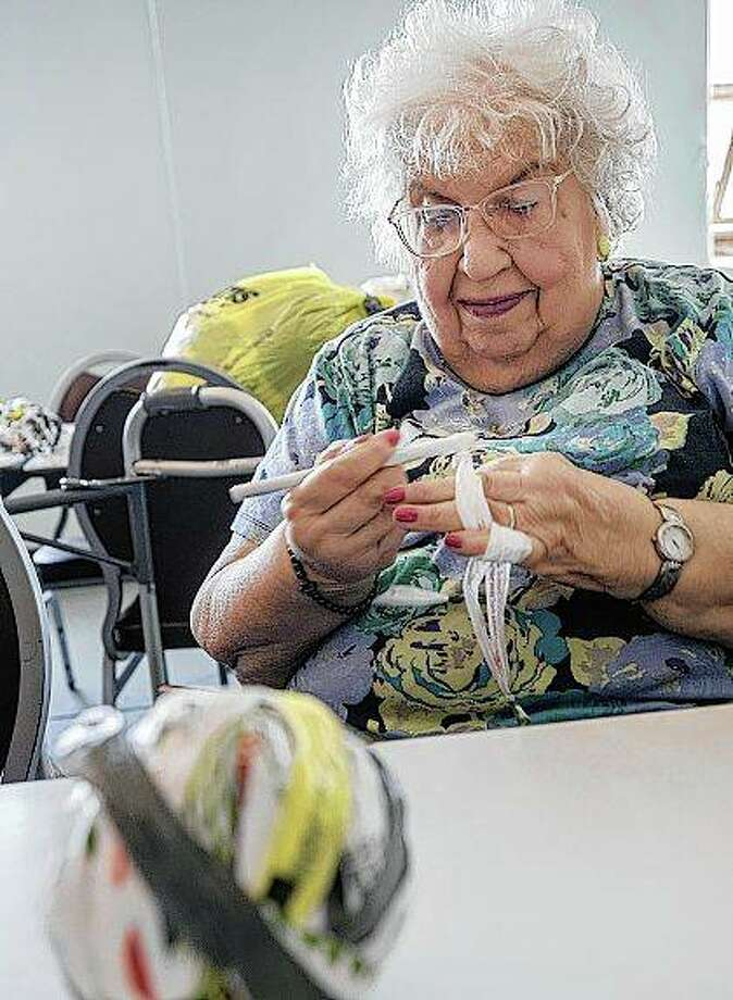 Tula Kronas crochets a sleeping mat in Danville. Members of the Order of the Eastern Star Iris chapter in Danville are creating sleeping mats made out of plastic shopping bags for homeless people. Photo: Rick Danzl | News-Gazette (AP)