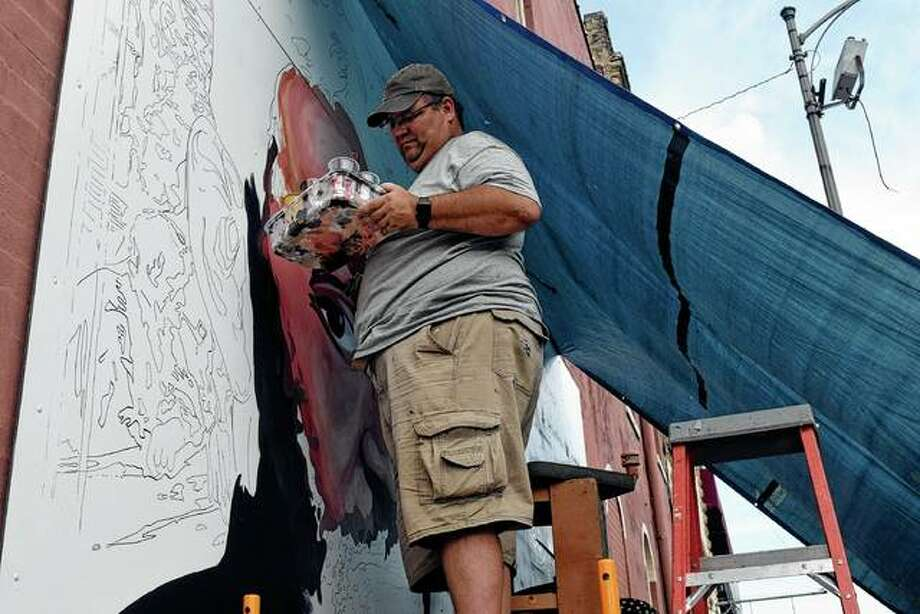 Scott Lindley works Thursday on the new Ulysses S. Grant mural on the north corner of East State Street and East Central Park Plaza. Photo: Samantha McDaniel-Ogletree | Journal-Courier