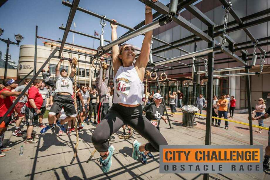 Two roads are closed Sunday morning in Stamford for the City Challenge Obstacle Race. Photo: / Contributed Photo /City Challenge