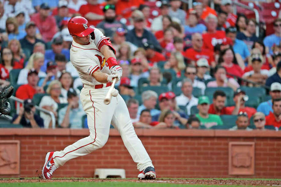 The Cardinals' Paul Goldschmidt hits a solo home run during the fourth inning Saturday against the Houston Astros at Busch Stadium. It was the sixth consecutive game in which Goldschmidt has homered. Photo: Associated Press