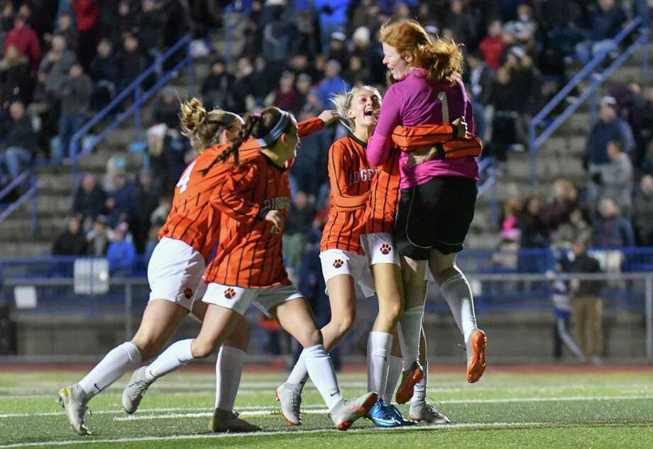 Members of the Ridgefield Tigers celebrate as time runs out during CIAC Class LL Soccer Championship against the Staples Wreckers on Sunday November 18, 2018, at West Haven High School in New Haven, Connecticut. Photo: Gregory Vasil / For Hearst Connecticut Media / Connecticut Post Freelance