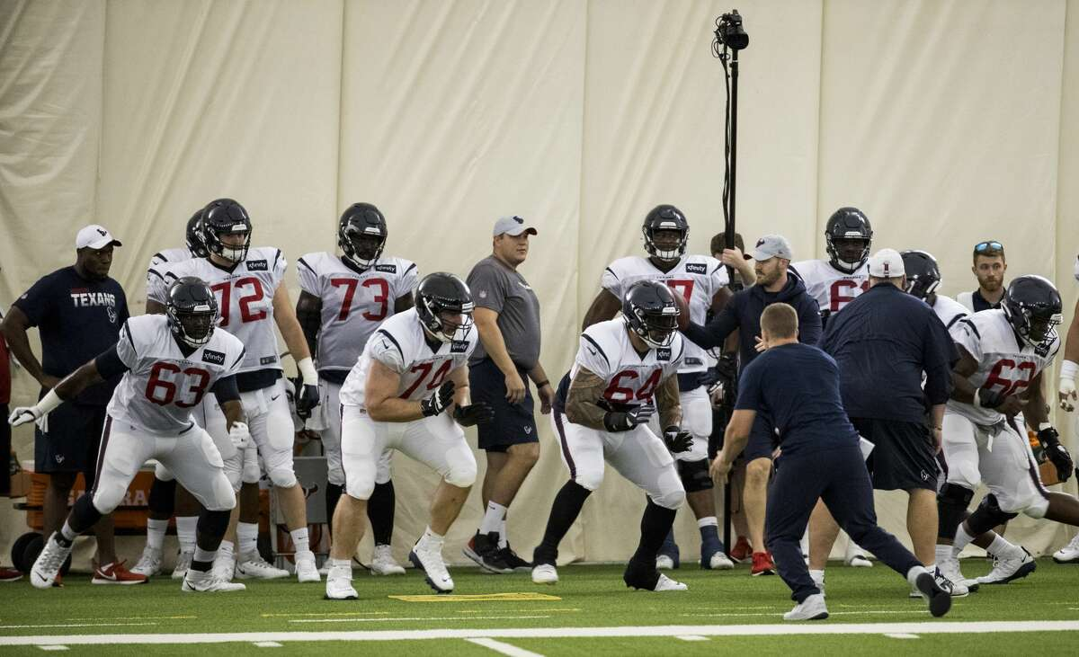 The Houston Texans offensive line fire off the ball during training camp at the Methodist Training Center on Sunday, July 28, 2019, in Houston.