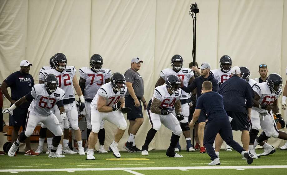 The Houston Texans offensive line fire off the ball during training camp at the Methodist Training Center on Sunday, July 28, 2019, in Houston. Photo: Brett Coomer/Staff Photographer