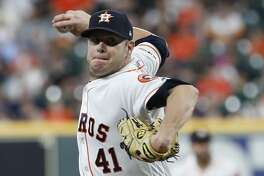 Houston Astros starting pitcher Brad Peacock (41) pitches during the first inning of an MLB baseball game at Minute Maid Park, Thursday, June 27, 2019, in Houston.
