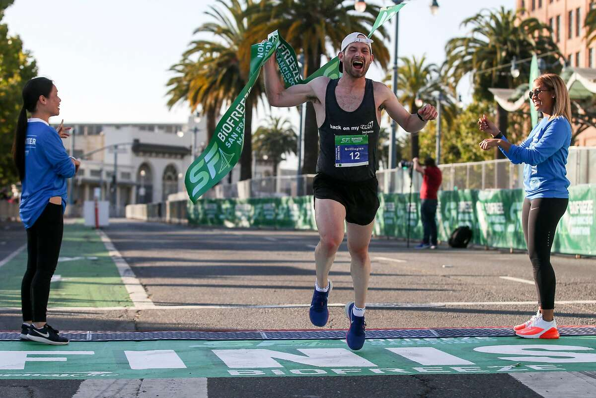 Mens Marathon winner Gregory Billington crosses the finish line at the San Francisco Marathon, one of the largest urban running events in the country, Sunday, July 28, 2019, in San Francisco, Calif.