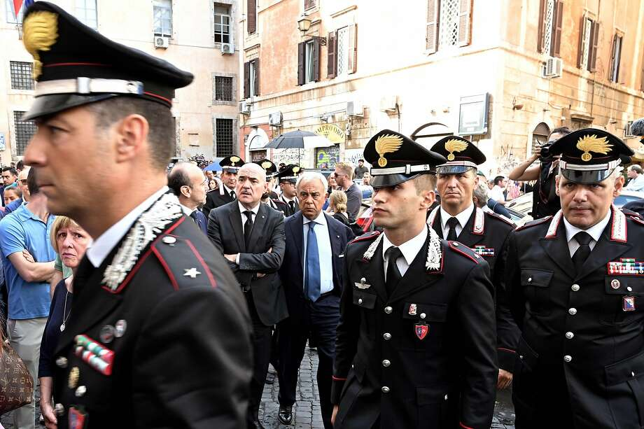Officers arrive at a Rome church to pay respects to Deputy Brig. Mario Cerciello Rega, who was slain. Photo: Vincenzo Pinto / AFP / Getty Images