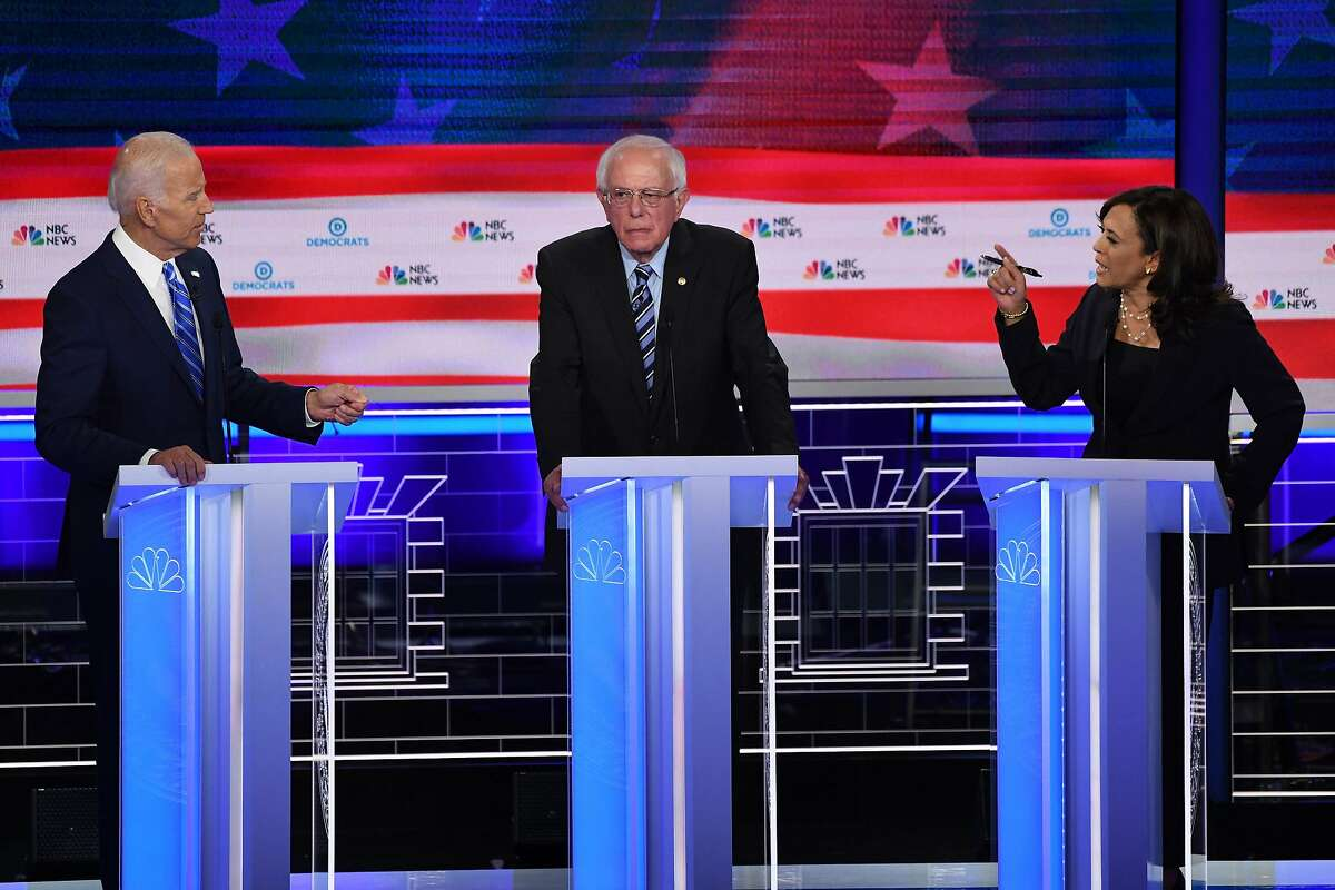 (FILES) In this file photo taken on June 27, 2019 Democratic presidential hopefuls (fromL) former US Vice President Joseph R. Biden Jr., US Senator for Vermont Bernie Sanders and US Senator for California Kamala Harris speak during the second Democratic primary debate of the 2020 presidential campaign season hosted by NBC News at the Adrienne Arsht Center for the Performing Arts in Miami, Florida. - Democrats are gearing up for their second primary debates ahead of the 2020 election, with a rematch looming between frontrunner Joe Biden and first round star Kamala Harris. Ten candidates including Senators Elizabeth Warren and Bernie Sanders will square off in Detroit on July 30, while Biden and Harris will share the stage with eight others the following night, after a draw of eligible participants by debate hosts CNN on July 18, 2019. (Photo by SAUL LOEB / AFP)SAUL LOEB/AFP/Getty Images