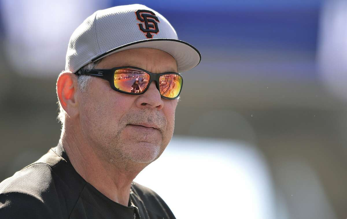 San Francisco Giants' Bruce Bochy looks on during batting practice before the baseball game against the San Diego Padres Saturday, July 27, 2019, in San Diego. The Giants won 2-1. (AP Photo/Orlando Ramirez)