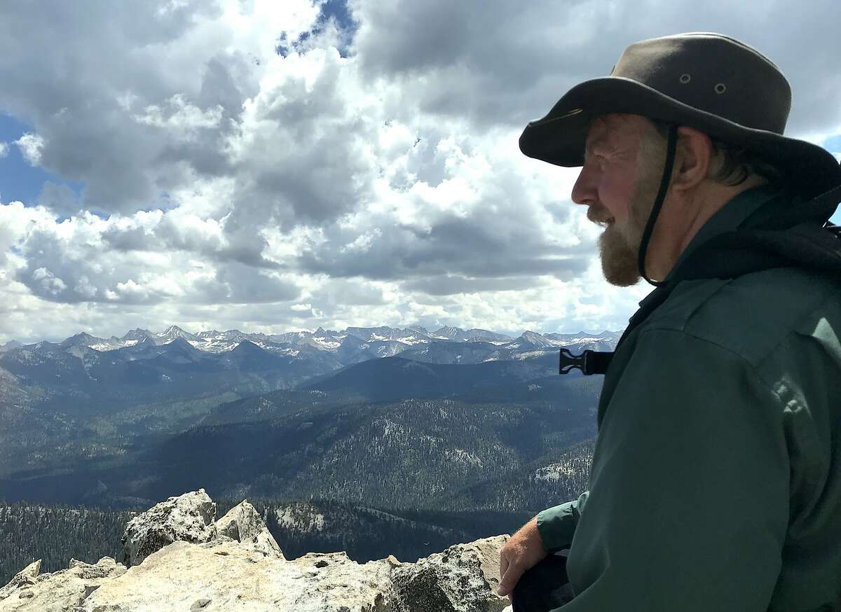 Chronicle outdoors writer Tom Stienstra takes in the view of the Sierra Crest from 10,365-foot Mitchell Peak in the Jennie Lakes Wilderness