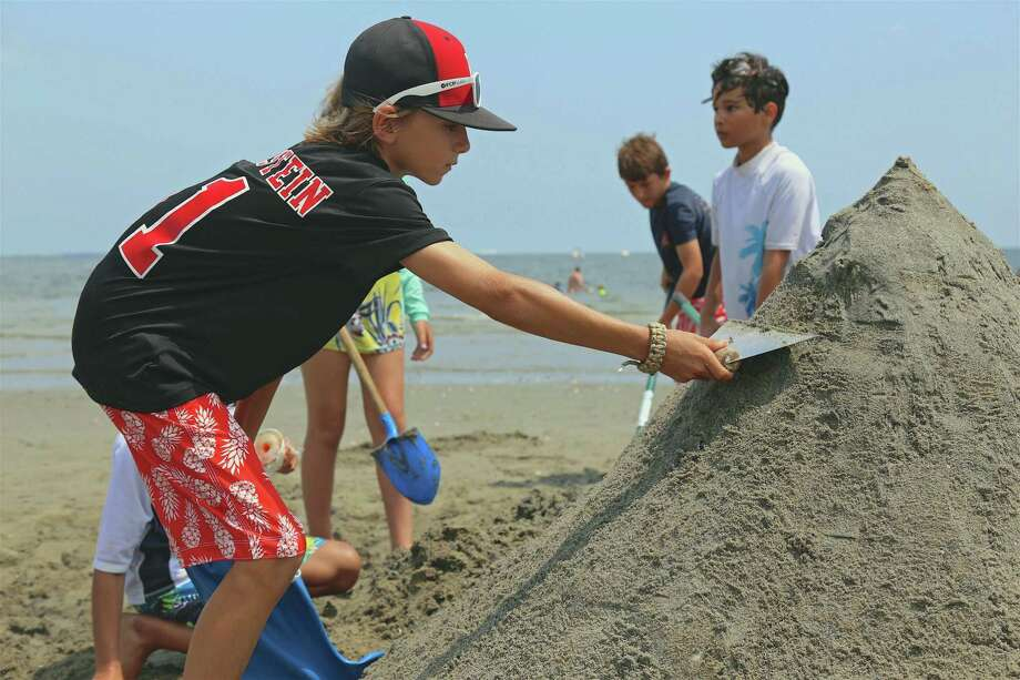 Jake Bernstein, 11, of Fairfield, works on a Hermit Crab sculpture at the annual P.A.L. Sandcastle Competition at Penfield Beach on Saturday, July 27, 2019, in Fairfield, Conn. Photo: Jarret Liotta / Jarret Liotta / ©Jarret Liotta