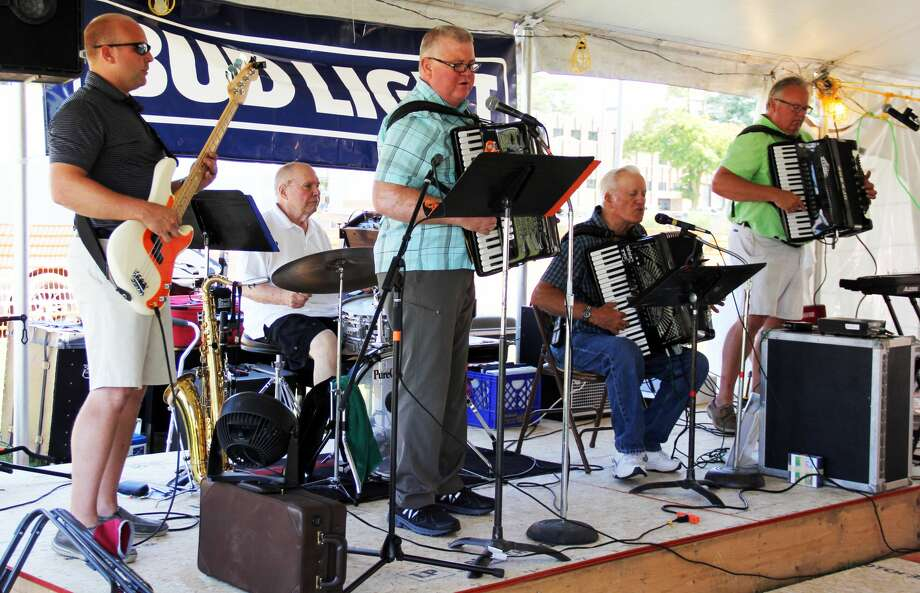Our Lady of Lake Huron Catholic Church holds a mass with a polka band playing in the background. This was part of their annual Holy Name of Mary Parish Festival. Photo: Andrew Mullin/Huron Daily Tribune