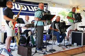 Our Lady of Lake Huron Catholic Church holds a mass with a polka band playing in the background. This was part of their annual Holy Name of Mary Parish Festival.