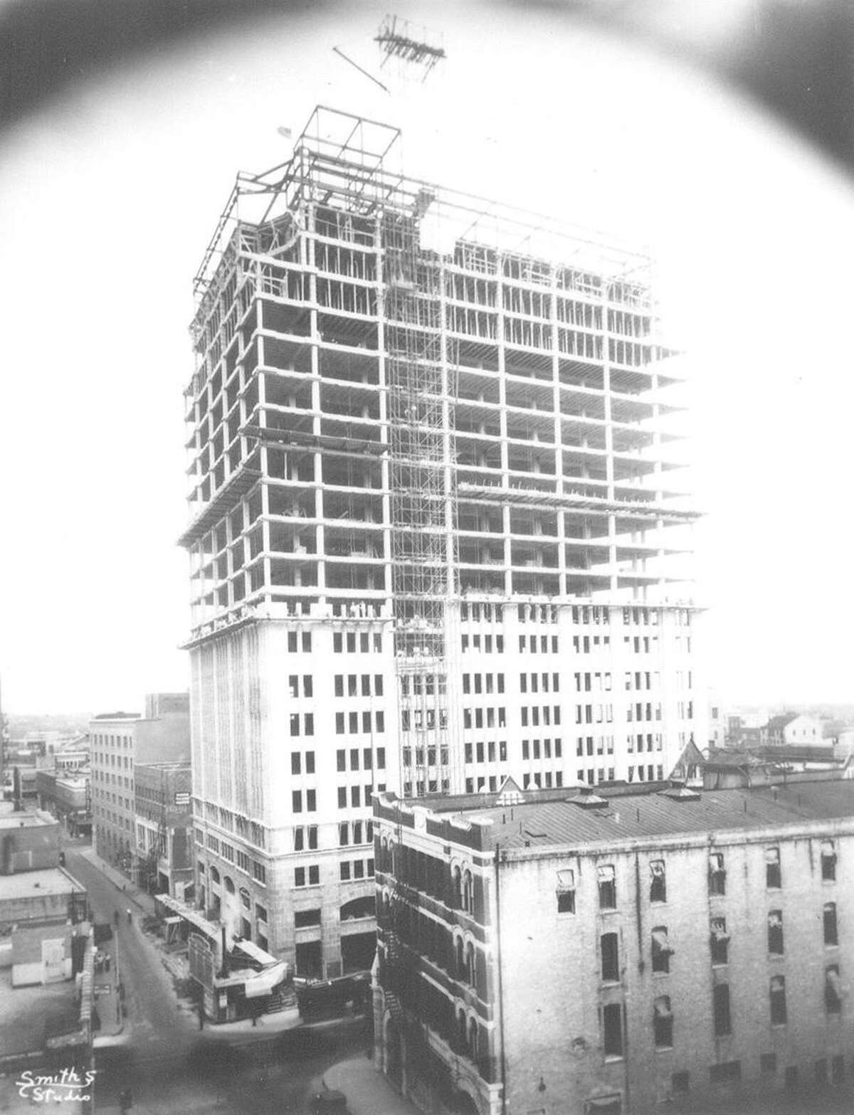 Looking east in 1930 on College Street toward the Nix building while under construction. Grayburg Building is in foreground.