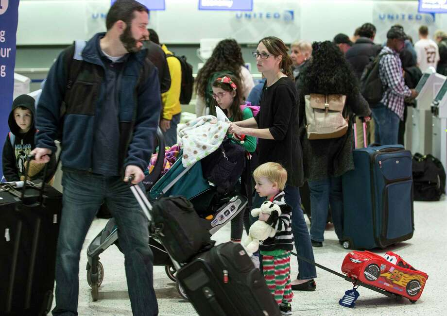 Airline passegers make their way through the ticketing area of Terminal C at George Bush Intercontinental Airport in advance of the Christmas holiday on Friday, Dec. 21, 2018, in Houston. More than 3 million passengers are expected to depart from, arrive to or connect through Bush Intercontinental Airport between Dec. 14 and Jan. 6. Photo: Brett Coomer, Houston Chronicle / Staff Photographer / © 2018 Houston Chronicle