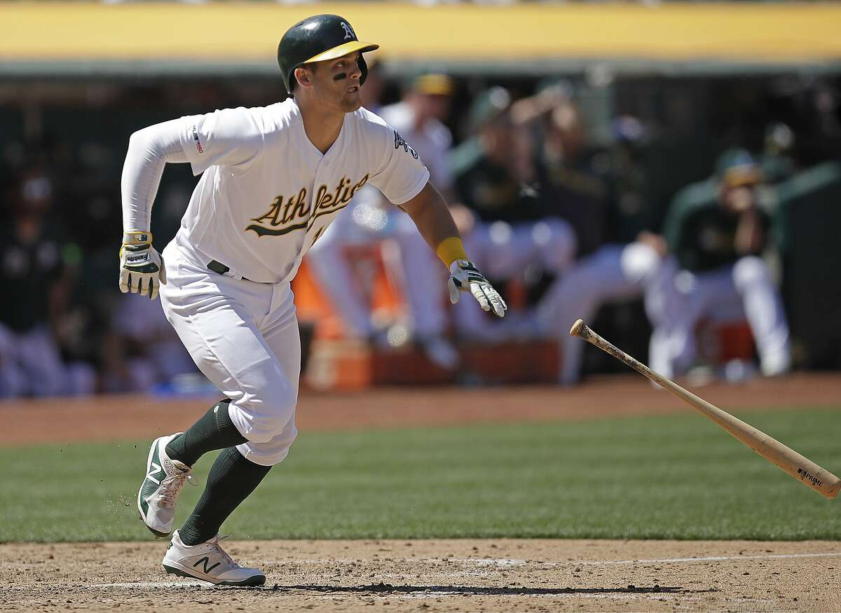 Oakland Athletics' Chad Pinder throws his bat after hitting a two-run double off Texas Rangers' Jesse Chavez in the sixth inning of a baseball game Sunday, July 28, 2019, in Oakland, Calif. (AP Photo/Ben Margot)