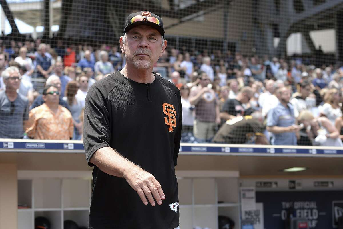 San Francisco Giants' Bruce Bochy walks onto the field before the baseball game against the San Diego Padres Sunday, July 28, 2019, in San Diego. (AP Photo/Orlando Ramirez)