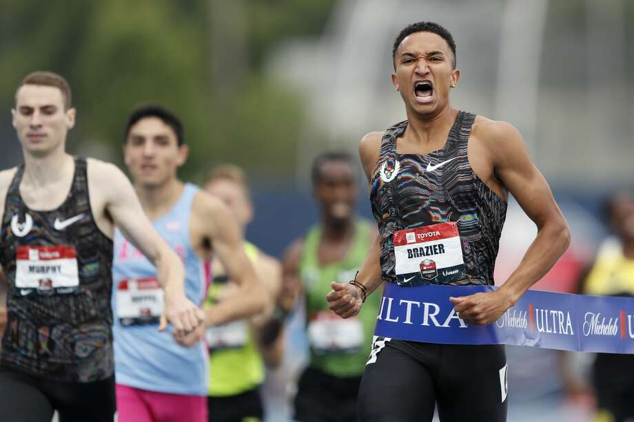 Donavan Brazier, right, celebrates as he wins the men's 800-meter run at the U.S. Championships athletics meet, Sunday, July 28, 2019, in Des Moines, Iowa. Bryce Hoppel is second from left in the background. Photo: Charlie Neibergall/Associated Press