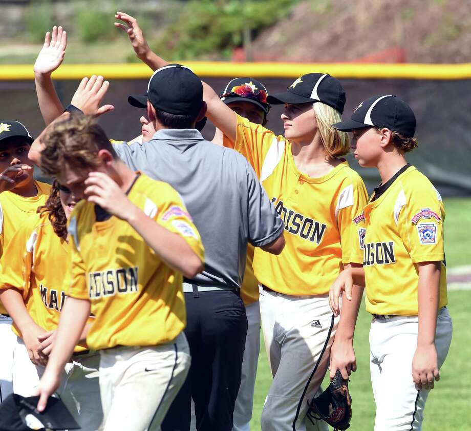 Chase Geremiah (right) of Madison high fives teammates after defeating Simsbury 6-2 in the Little League state tournament in Willimantic on July 28, 2019. Geremiah hit a grand slam in the second inning. Photo: Arnold Gold / Hearst Connecticut Media / New Haven Register