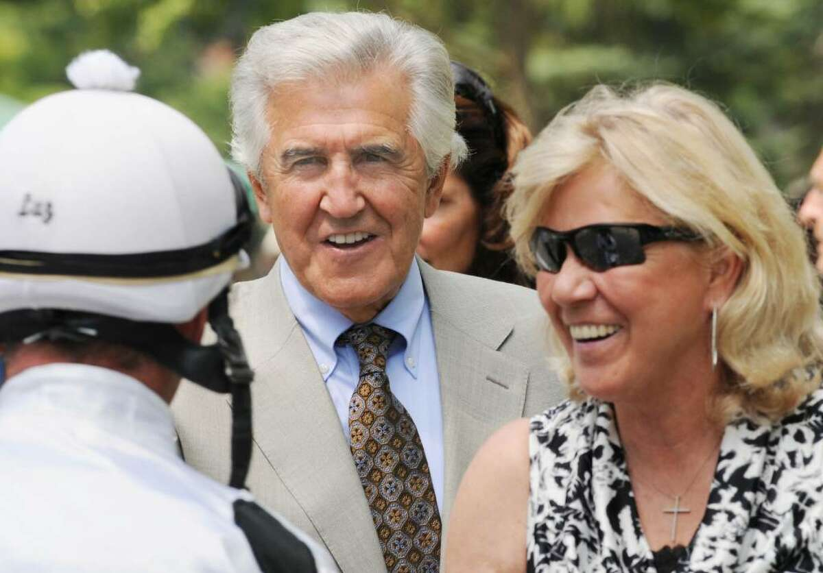 Former New York State Senate Majority Leader Joe Bruno, center, in the paddock with Kay Stafford, right, at Saratoga Race Course as they greet jockey Michael Luzzi before the fourth race as Dixie Nite Out, the No. 4 horse prepares to ride. (Luanne M. Ferris / Times Union)