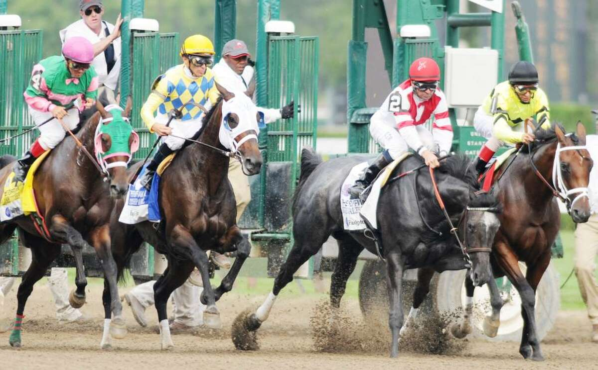 From left: No. 4 Classofsixtythree, with Javier Castellano in the irons; No. 3 Starship Angle, with Jockey Garrett Gomez aboard; No. 2 Unrivaled Belle, with Kent Desormeaux up, stumbles; and No. 1 Malibu Prayer, the eventual winner ridden by Jockey John Velazquez, rides along the rail just out of the gate the Ruffian. (Luanne M. Ferris / Times Union)
