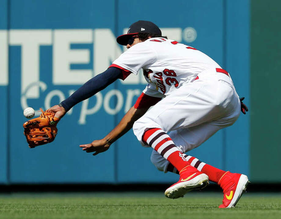 Cardinals right fielder Jose Martinez is unable to catch a double by the Astros' George Springer during the eighth inning Sunday at Busch Stadium.