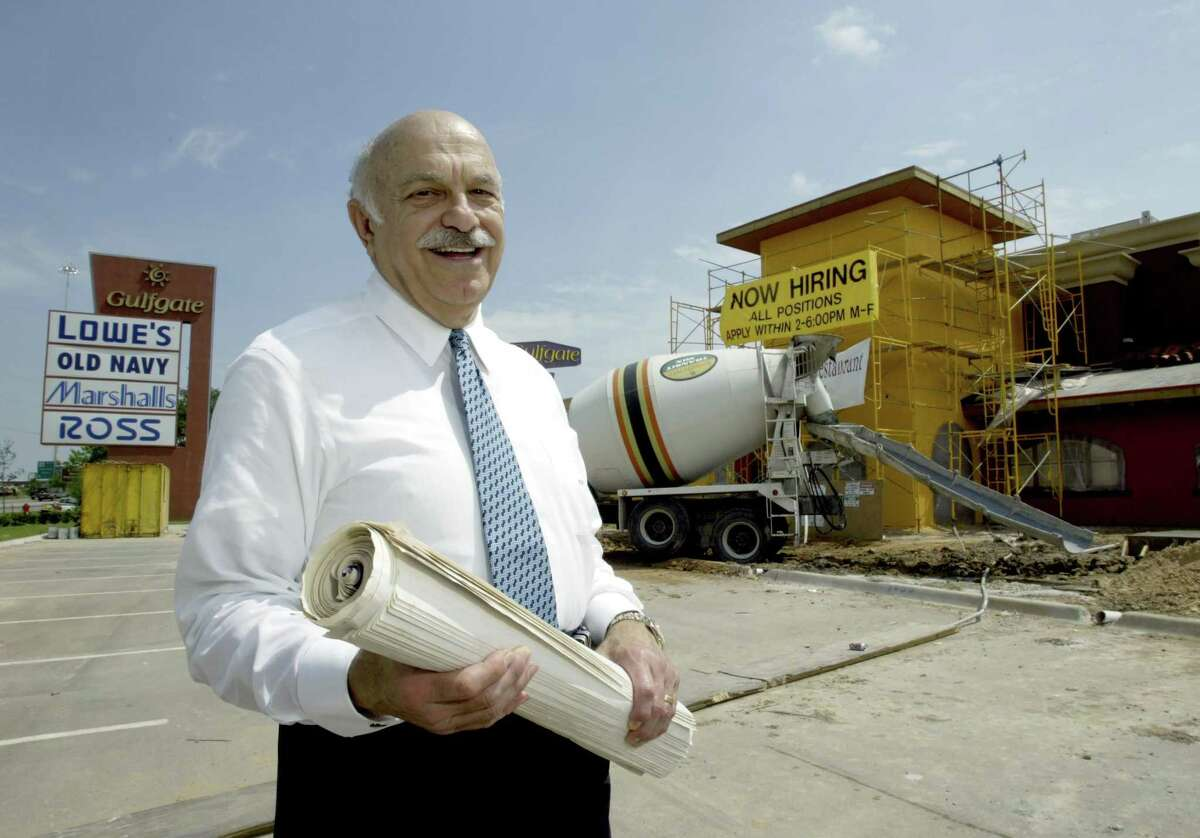 Shopping center developer and civic leader Ed Wulfe poses by a new Doneraki restaurant in this April 18, 2003 file photo.