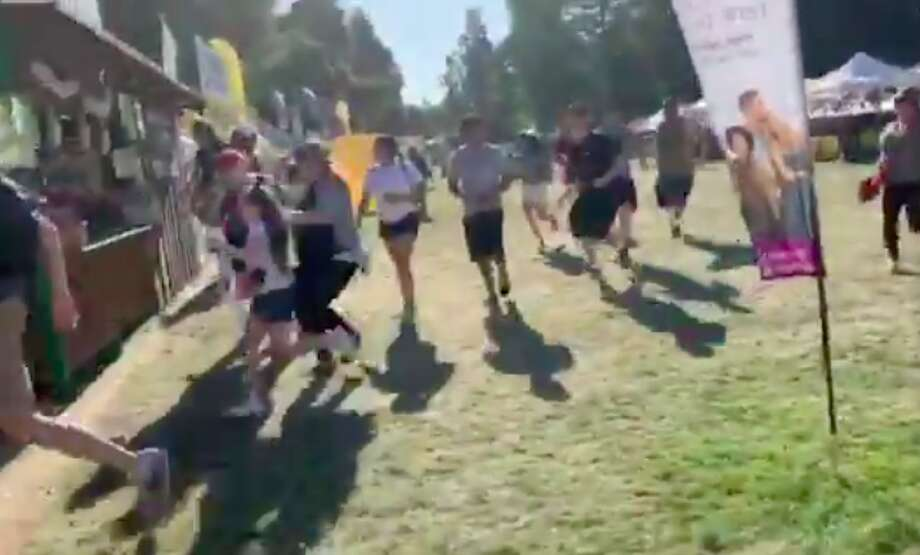 Screenshots of a video showing attendees at Gilroy Garlic Festival running from apparent gunshots Sunday afternoon. Photo: Courtesy @wavyia / Twitter